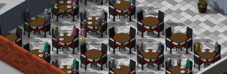 A cafe with tables and students sitting at some of those tables
